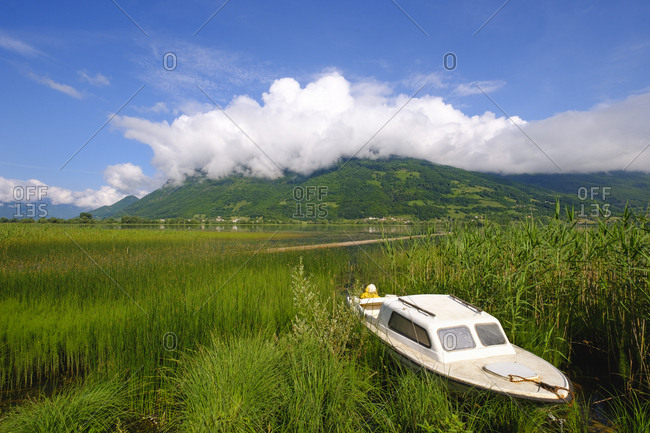 Montenegro- Plav- Plavsko jezero- motorboat at lakeside