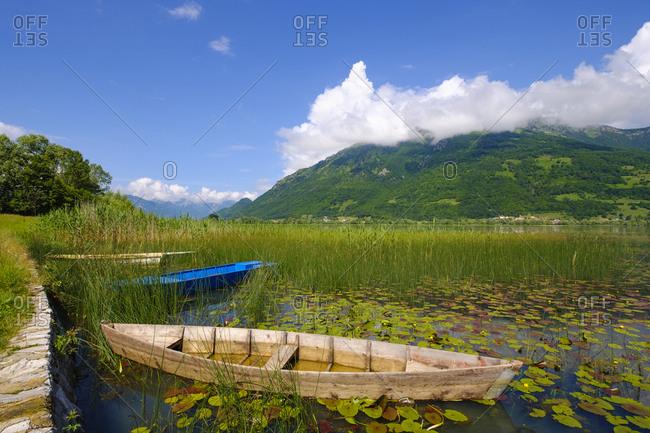 Montenegro- Plav- Plavsko jezero- boat at lakeside