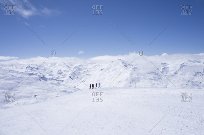 France- French Alps- Les Menuires- Trois Vallees- skiers enjoying view at distance