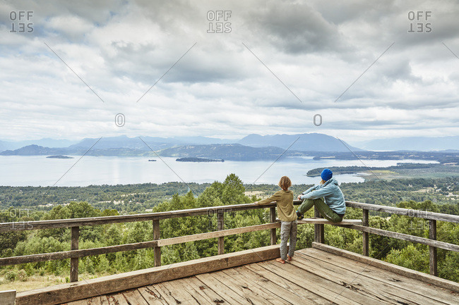 Chile- Puren- Nahuelbuta National Park- woman with son on observation terrace overlooking the lake