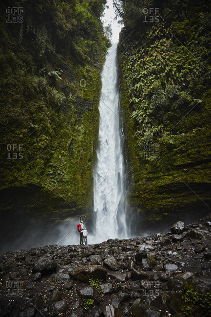 Chile- Patagonia- Osorno Volcano- mother and son standing at Las Cascadas waterfall