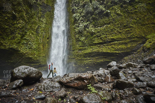 Chile- Patagonia- Osorno Volcano- mother and son walking at Las Cascadas waterfall