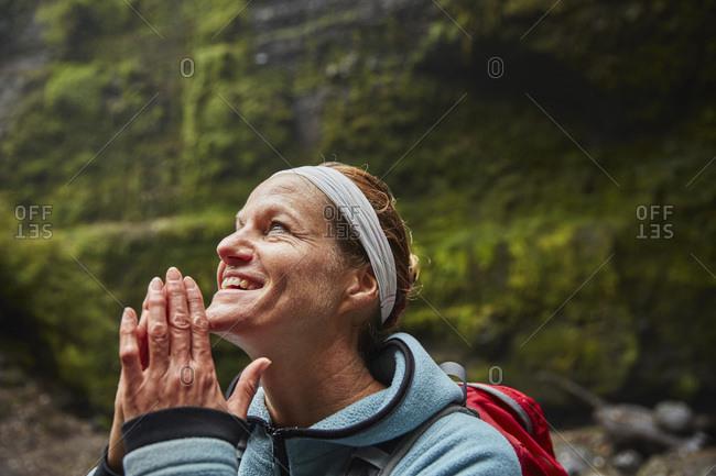 Chile- Patagonia- Osorno Volcano- portrait of woman admiring Las Cascadas waterfall