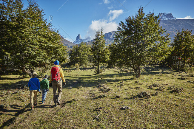 Chile- Cerro Castillo- mother with two sons on a hiking trip