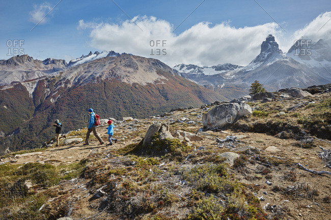 Chile- Cerro Castillo- mother with two sons on a hiking trip in the mountains