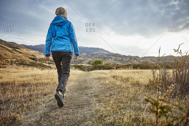 Chile- Valle Chacabuco- Parque Nacional Patagonia- woman on a hiking trip in steppe landscape