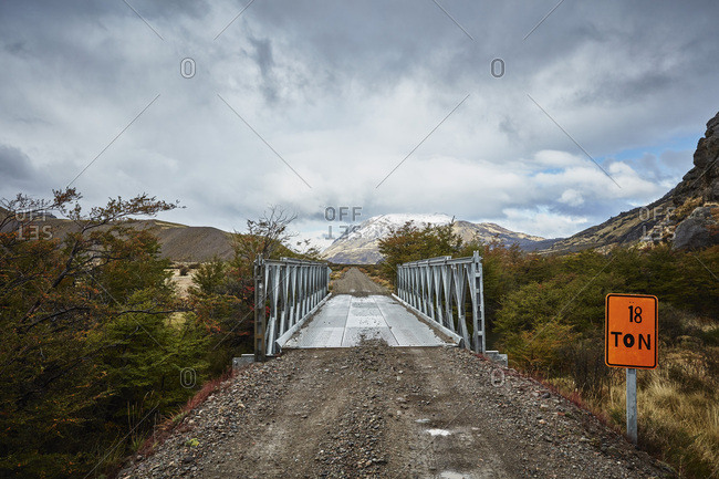 Chile- Valle Chacabuco- Parque Nacional Patagonia- gravel road in mountainscape at Paso Hondo