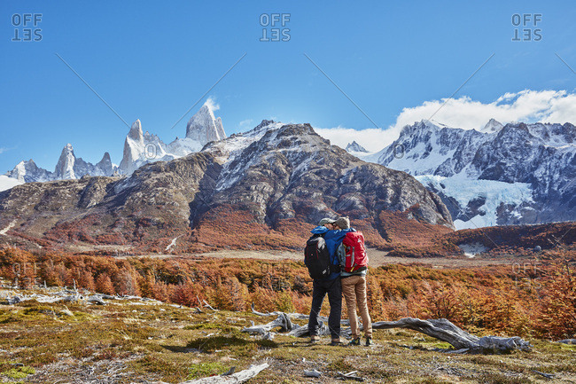 Argentina- Patagonia- El Chalten- couple on a hiking trip kissing at Fitz Roy massif
