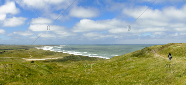 Denmark- Jutland- woman walking in dune landscape