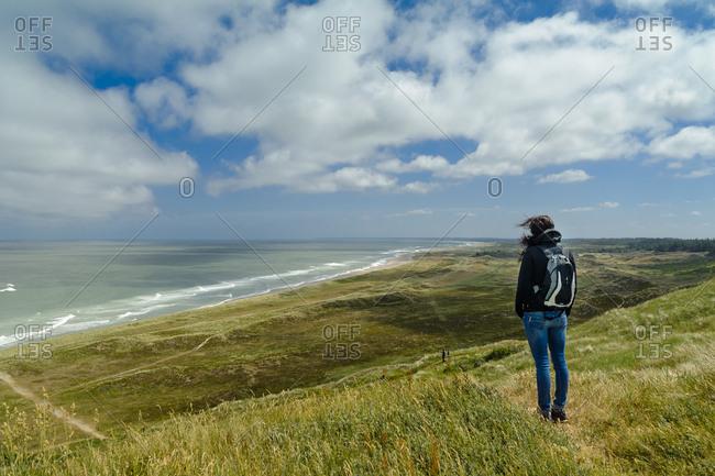 Denmark- Jutland- woman standing in dune landscape