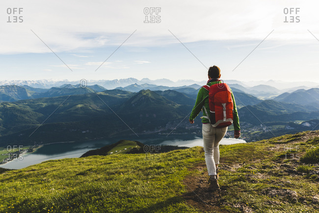 Austria- Salzkammergut- Hiker with backpack hiking in the Alps