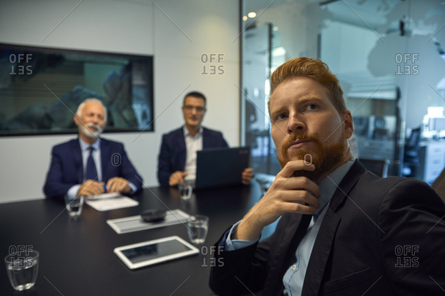 Portrait of businessman turning round in a meeting