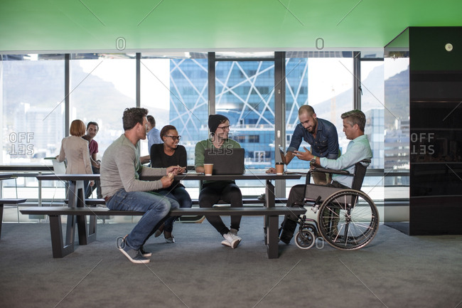 Group of people having a meeting in modern office