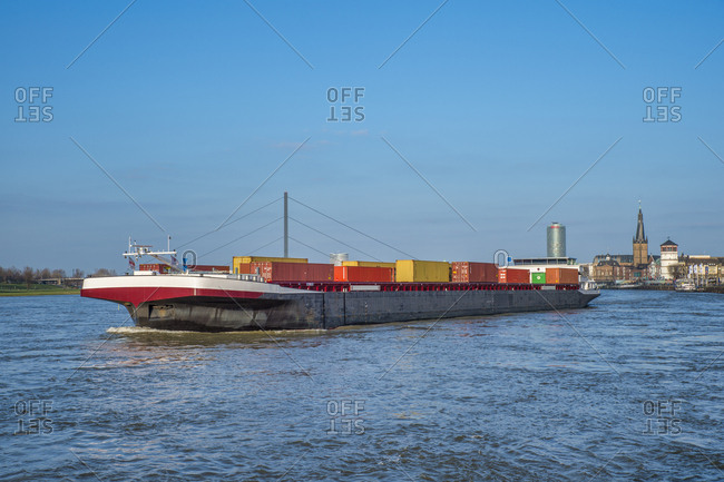 Germany - January 14, 2018: Duesseldorf- cargo ship transporting containers at Rhine River