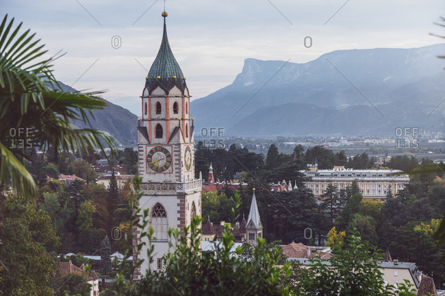 Italy - October 4, 2017: Alto Adige- Meran- cityscape with St. Nicholas' Church in the evening