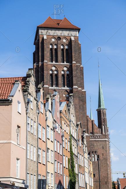 Poland - August 16, 2018: Gdansk- Hanseatic league houses with Saint Mary's church
