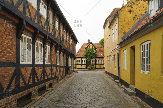 Denmark - June 11, 2018: Jutland- Ribe- picturesque alley with timber-framed houses