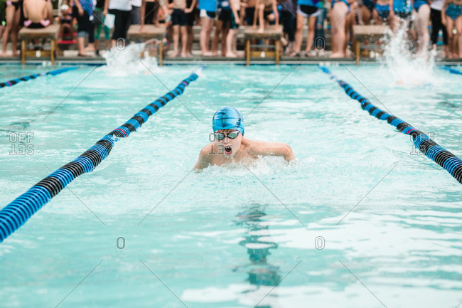 Boy doing the butterfly at a swim meet