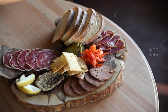 Charcuterie board with meat and crackers