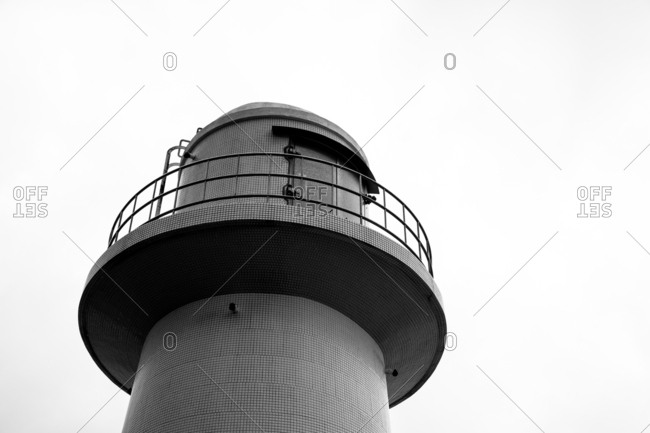 Low angle view of the top of a lighthouse in black and white