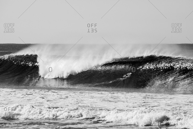 Black and white image of waves rolling in the ocean