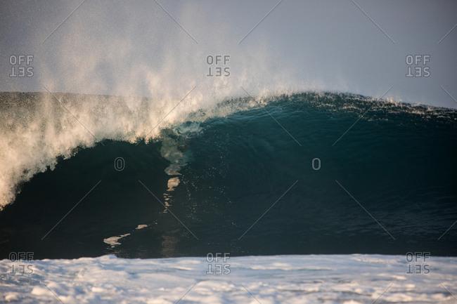 Splashing wave rolling in the ocean