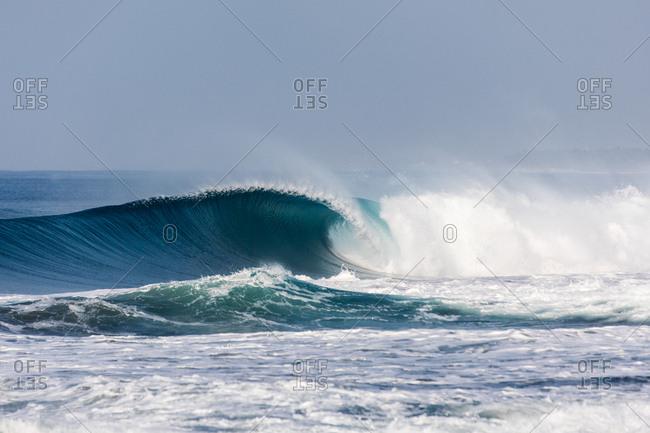 Blue curling waves in the ocean