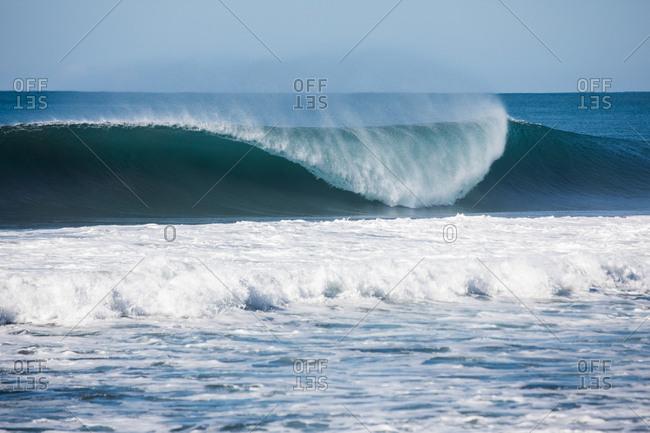 Beautiful blue curling waves in the ocean