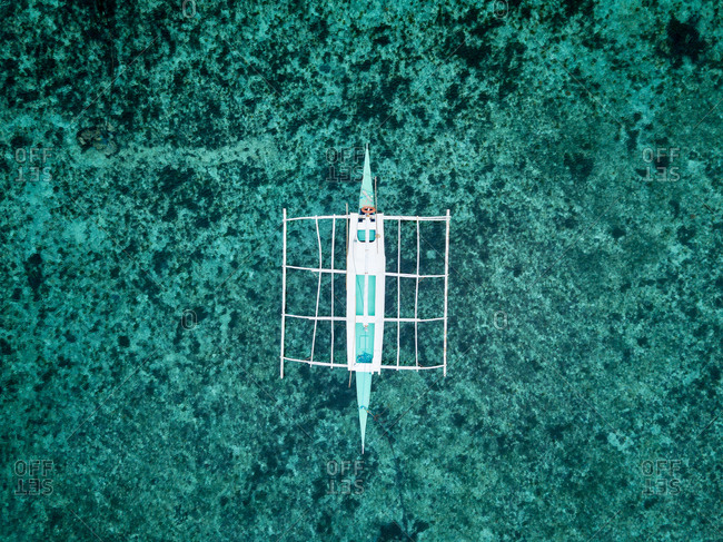 Aerial view of a typical philippines boat on the beach