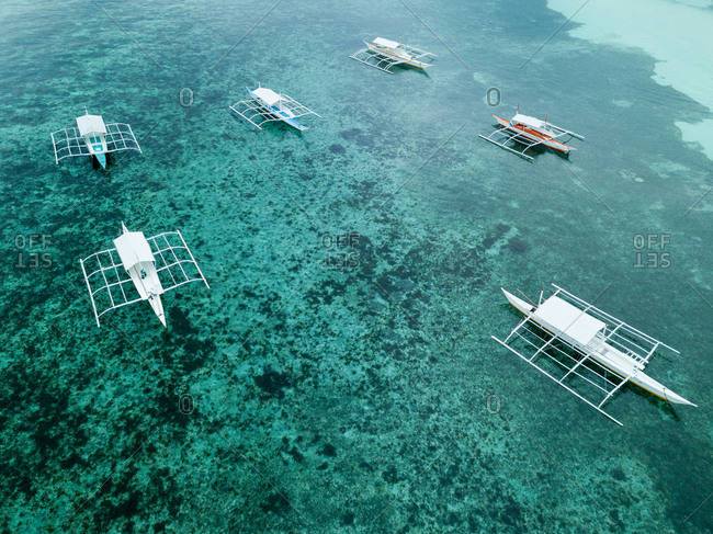 Aerial view of typical philippines boats on the beach