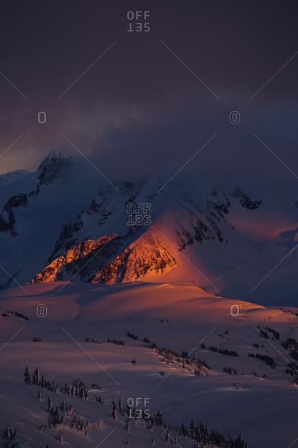 Orange light on a snowy mountain