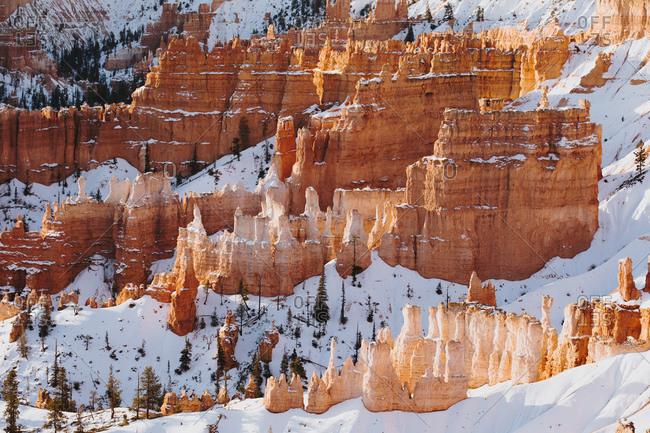 Snowfall in red rock mountain range