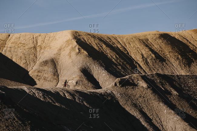 Person biking on large dunes