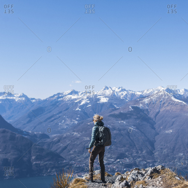 Hiker woman on top of the mountain over lake