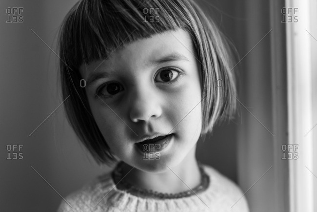 Portrait of a preschool girl with bangs.