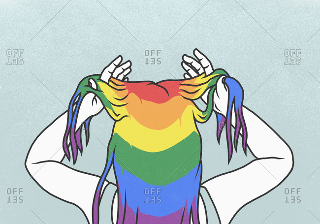 Woman with hands in rainbow hair