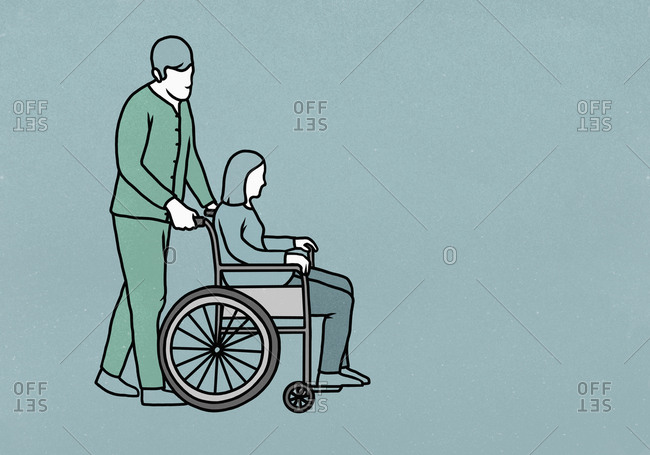 Male nurse pushing woman in wheelchair