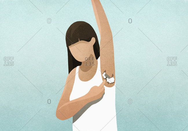 Woman shaving armpit