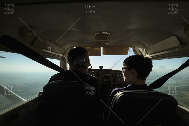 Father and son flying in small airplane