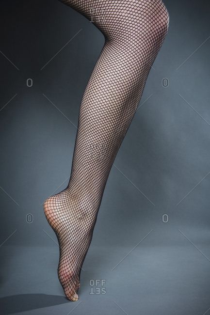 Womans leg in fishnet stocking