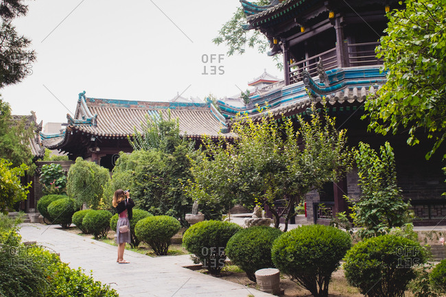 Woman photographing temple in Xi'an, China