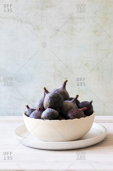 Cute scalloped bowl full of ripe figs