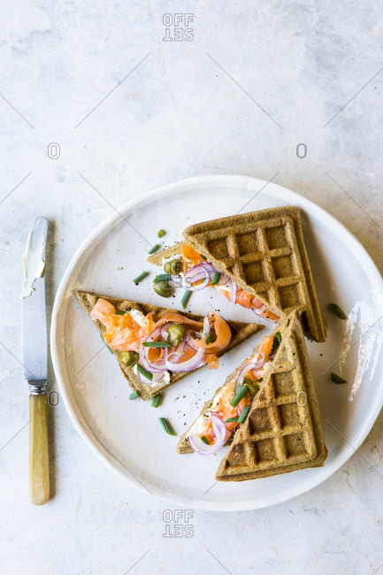 Brunch dish of savory salmon topped whole grain waffles