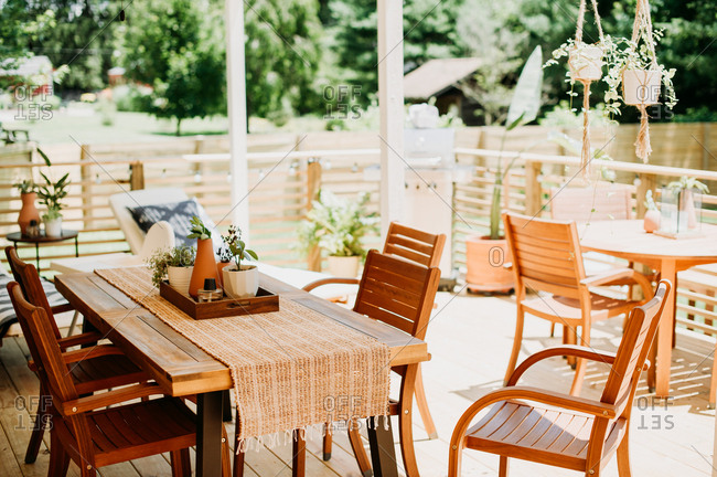 Backyard deck with wooden table sets