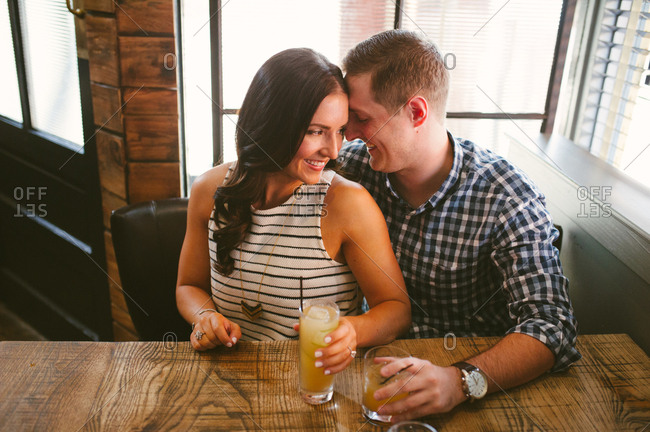 Couple enjoying cocktails in a restaurant