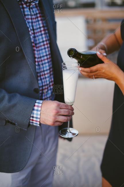 Couple enjoying champagne as engagement celebration