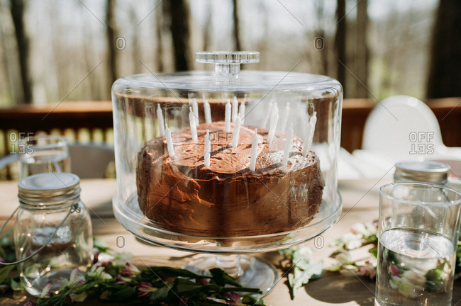 Chocolate Birthday Cake On An Outdoor Table