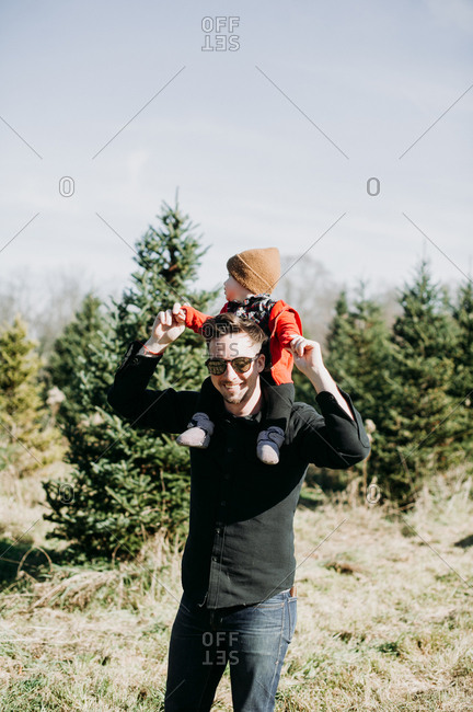 Father and baby on a Christmas tree farm