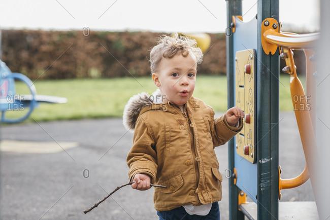 Kid playing with playground equipment