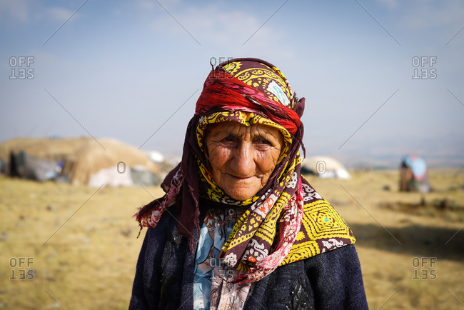 Portrait of an old woman in a village
